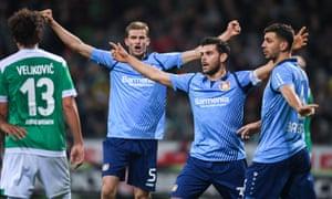 Leverkusen's players celebrate during their 6-2 win in Bremen.