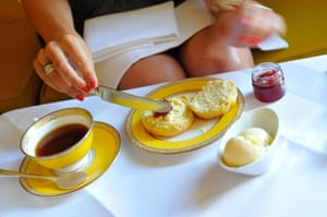 Jam and cream on a scone during afternoon tea