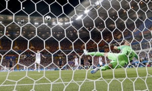 Iceland's Gylfi Sigurdsson fires the ball into the roof of the net.