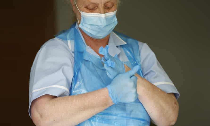 Care home worker dons PPE