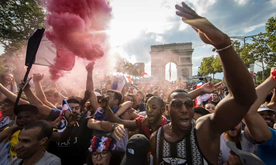 French supporters celebrate on the Champs-Elysées after France won the 2018 World Cup