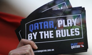 A demonstrator's leaflet critical of Qatar's policies regarding the working conditions of migrant workers providing infrastructure for the country to host the World Cup in 2022.