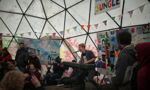 Tom Odell performing at the Calais Jungle camp