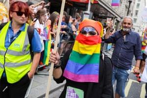 A parade-goer wears a rainbow niqab.
