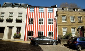 The multimillion-pound townhouse painted with red and white stripes in South End, Kensington.