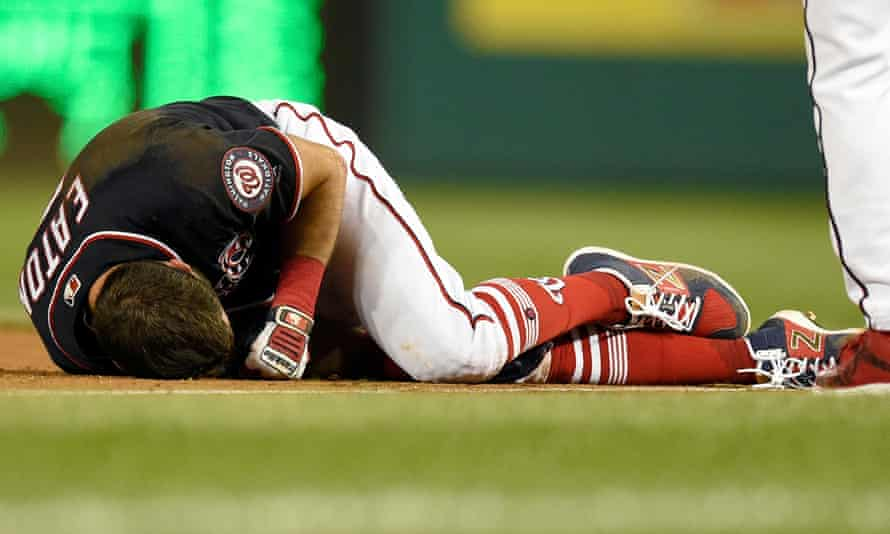 Washington Nationals' Adam Eaton lies on the field after he was injured on a play at first base during the game against the New York Mets last month.