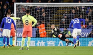 Leicester's Kasper Schmeichel saves a penalty from Manchester City's Sergio Agüero.