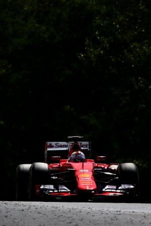 Sebastian Vettel approaches debris on the track.