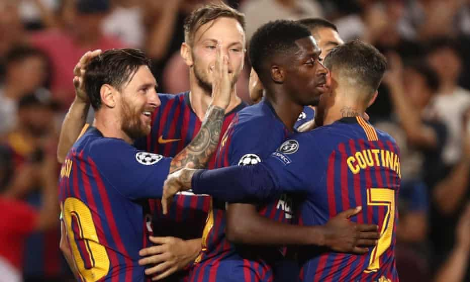Lionel Messi (left) celebrates with his Barcelona teammates after the third goal