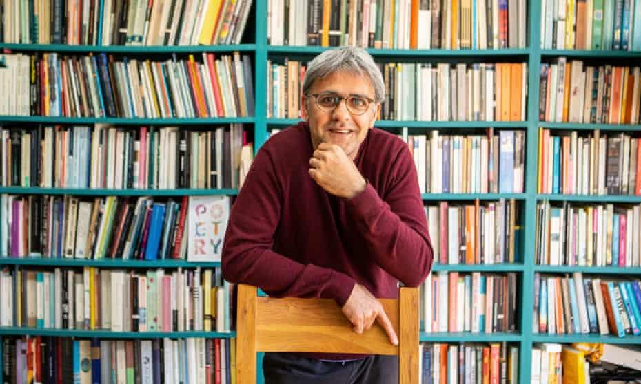 Daljit Nagra in front of bookcase.