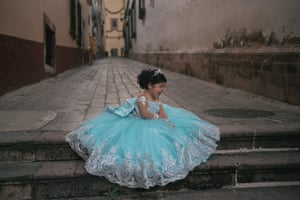 A child cries during a birthday photoshoot in the historic town of Zacatecas
