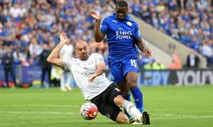 Jeff Schlupp of Leicester City is challenged by Darron Gibson of Everton resulting in a penalty kick.