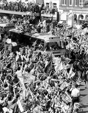 The West Ham team parades the FA Cup from a coach near Upton Park the morning after beating Arsenal at Wembley