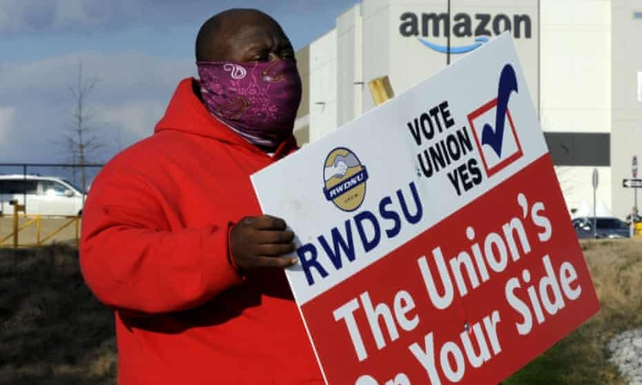 Michael Foster of the Retail, Wholesale and Department Store Union shows the union's support for Amazon workers in Bessemer, Alabama.