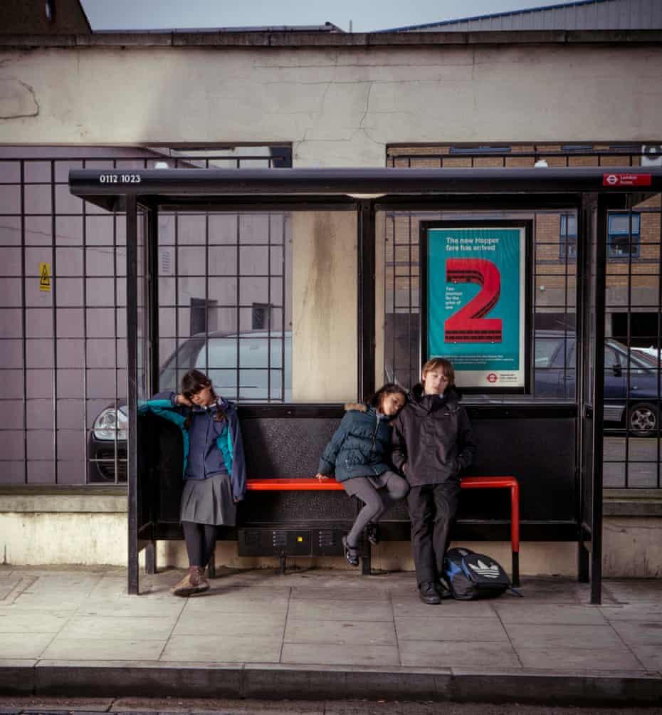 Children falling asleep at a bus stop