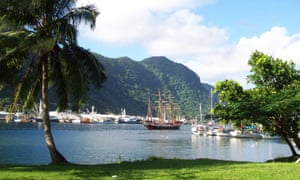 A sailing ship stands in the harbor at Pago Pago, capital of American Samoa.