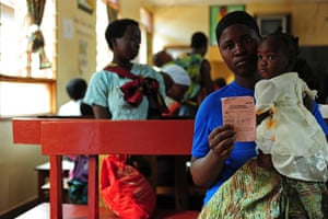 A mother shows her baby's vaccination certificate in Rumphi, northern Malawi.