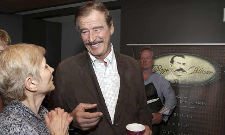 Former president of Mexico Vicente Fox talks with Tana Lee Tolson from Nurses Union for Cannabis Hospices before a news conference held by commercial marijuana company in Seattle, Washington, in May 2013.