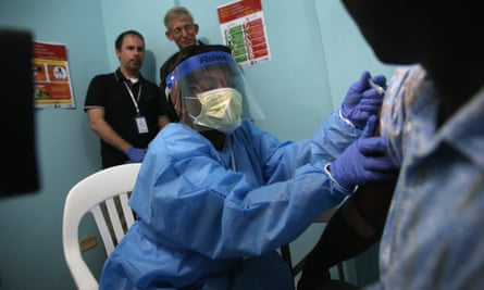 A nurse administers an injection as part of Ebola vaccine trials at Redemption hospital, in Monrovia, Liberia, in February 2015