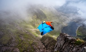 Howell leaps from Lord Berkley's Seat on An Teallach.