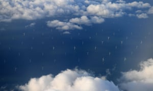 TOPSHOT - Burbo Bank Offshore Wind Farm on the Burbo Flats in Liverpool Bay, operated by DONG Energy, is pictured from the the window of an aircraft flying over the Irish Sea, off the west coast of northern England, on November 8, 2017. British energy supplier SSE and German-owned Npower said Wednesday they have agreed to merge their businesses that heat and light up millions of UK households. SSE, the second largest energy supplier in Britain, said it would spin off its household energy and services business and combine it with Npower, the British arm of Germany's Innogy.  / AFP PHOTO / Paul ELLISPAUL ELLIS/AFP/Getty Images