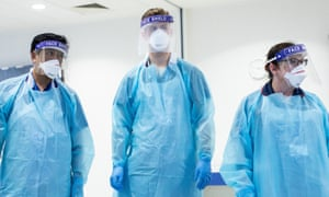 Clinicians in PPE. The guidance will be a reversal of Public Health England (PHE) guidelines.