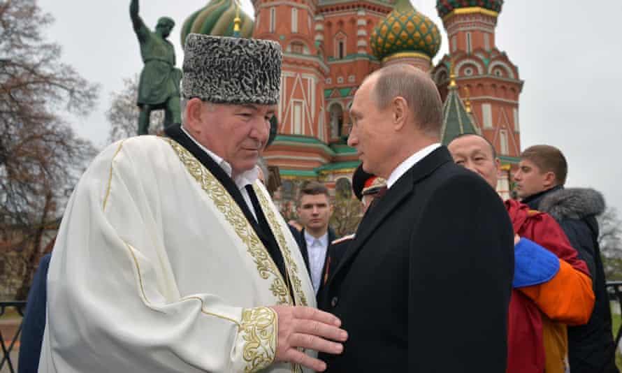 Mufti Ismail Berdiyev pictured with Vladimir Putin in 2015.