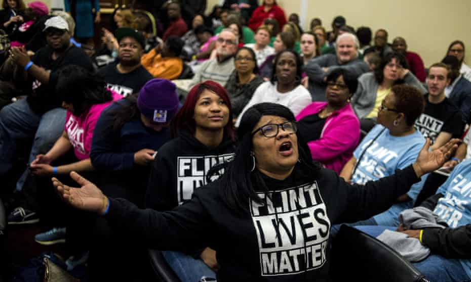 Flint resident Lisia Williams, shouts out as Governor Rick Snyder answers questions from US representatives during a hearing about the Flint water crisis on 17 March 2016 in Washington.