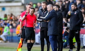 Referee Keith Stroud discusses alleged homophobic chants from the crowd with Millwall's manager, Gary Rowett, and Reading's Mark Bowen.