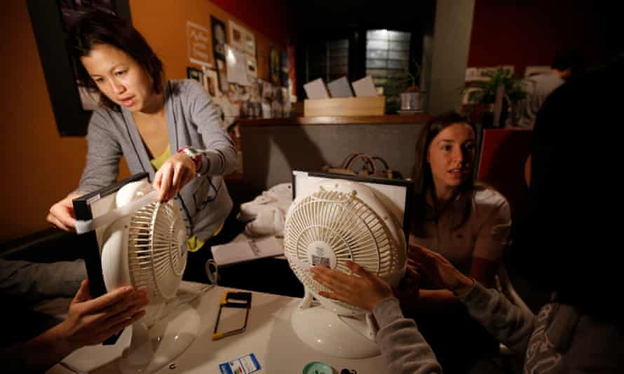 People assemble homemade air purifiers at a workshop hosted by Smart Air China in Shanghai, 2014.