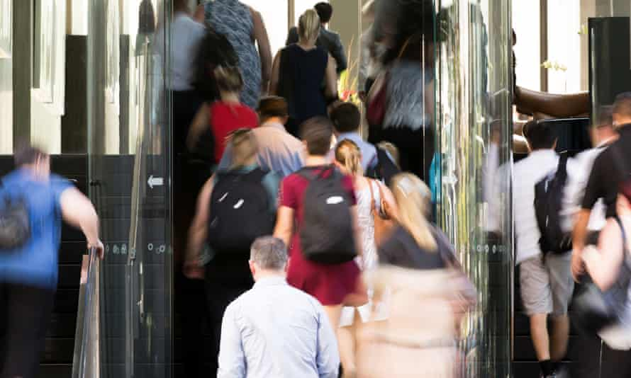 Office workers enter a building in Brisbane