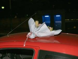 Flowers on the roof of Melissa's (Edmonds girlfriend's) car.