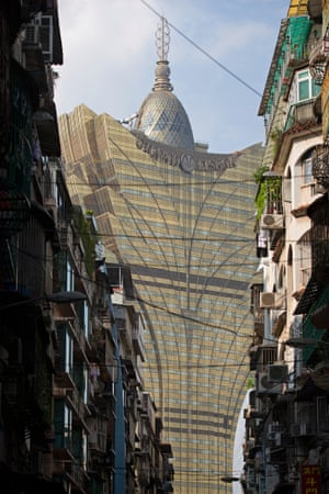 Grand Lisboa and contrasting local residential buildings,Macau