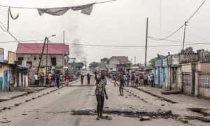 A protester gestures in the middle of the street in Kinshasa's Yolo neighbourhood.