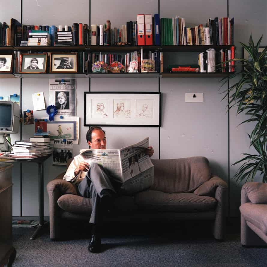 Charles Moore in 2001, when he was editor of the Daily Telegraph, in his Canary Wharf office.