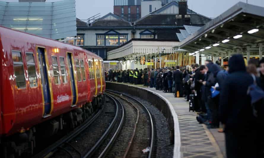 Commuters on a platform at Clapham Junction
