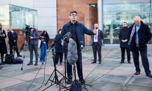 Andy Burnham speaking at a press conference outside The Bridgewater Hall in Manchester.