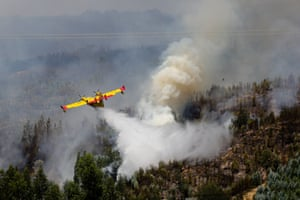 A Spanish Canadair fire fighting aircraft drops water over the Pedrogao Grande forest fire