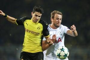 Dortmund's Marc Bartra challenges Harry Kane.