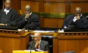 Jacob Zuma, centre, was trying to give his state of the nation address in parliament when the EFF walked out.