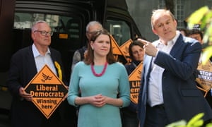 Lib Dem MP Sir Ed Davey (pointing) with Jo Swinson