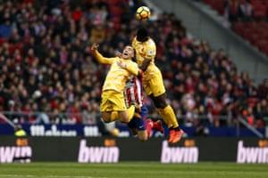 Girona pair Borja Garcia and Michael Olunga rise for a ball.