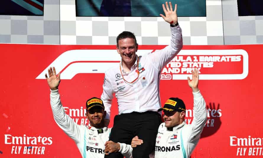 Valtteri Bottas (right) and Lewis Hamilton hoist aloft James Allison, technical director at Mercedes.