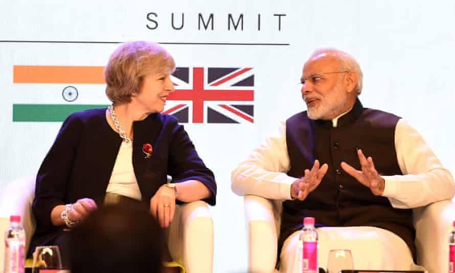 Britain's prime minister Theresa May speaks with India's prime minister Narendra Modi at the India-UK tech summit in New Delhi last year.