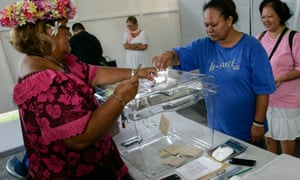Woman casts her vote in Tahiti.