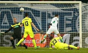 Julian Draxler scores his, and Wolfsburg's, second goal of the game in a match that left them in pole position to qualify for the last eight.