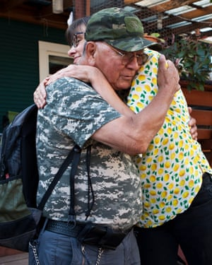 Homeowner Kim Sherman and Robert Desjarlais, the homeless man chosen to live in her backyard, share a hug during construction.