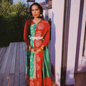 Tahmina Begum in her red and green georgette Sari