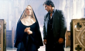 Frankie Thorn as a nun kneeling in church next to Harvey Keitel who is also kneeling and looking at her