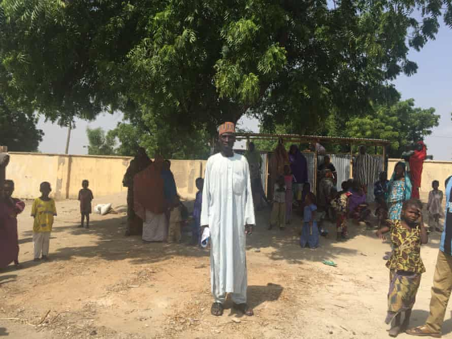 Modu Amsami stands next to a tree that he says would once have been submerged by Lake Chad